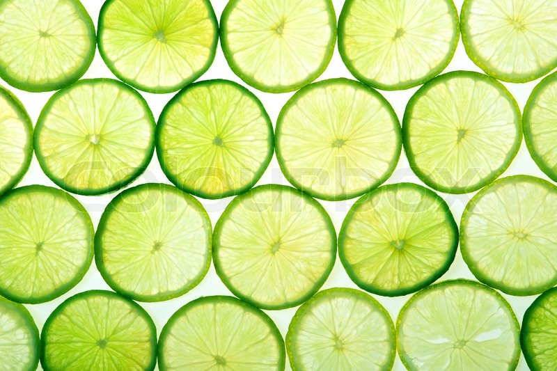 A lot of green lime slices on white background | Stock Photo | Colourbox