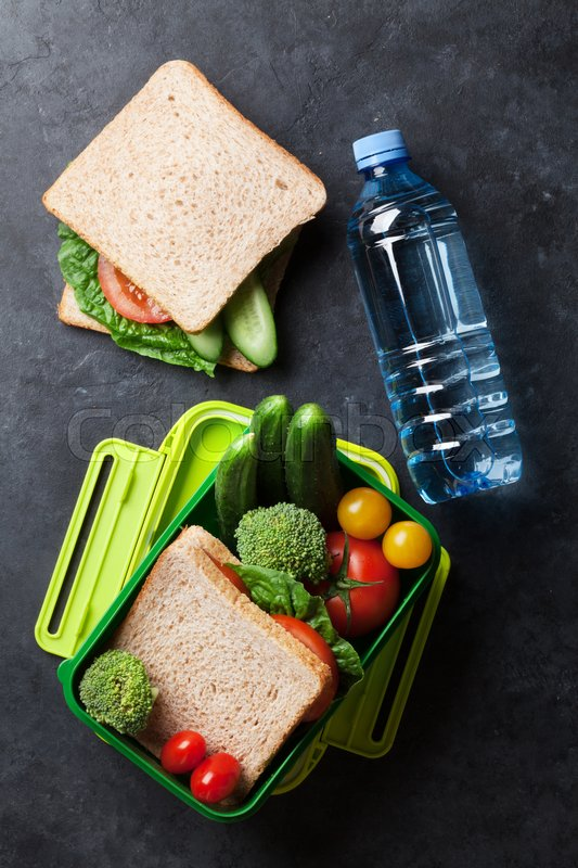 Lunch box with sandwich and vegetables      | Stock image