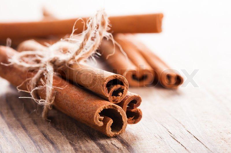 Cinnamon sticks close up on wooden table stock photo
