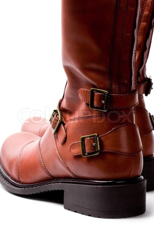 3606c41ccc68 Par brune støvler closeup på hvid ...