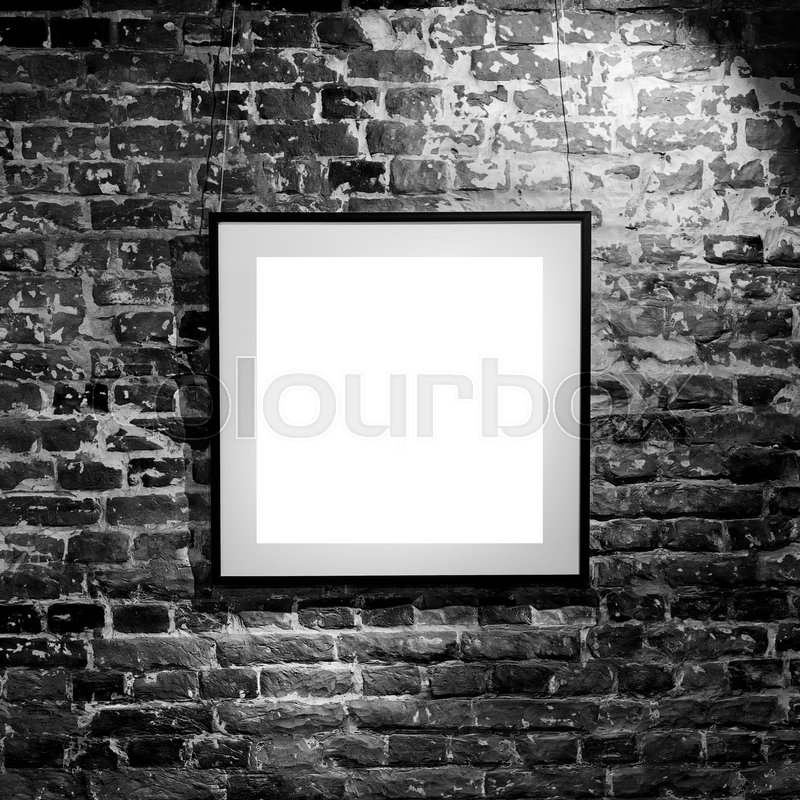 Empty square frame on black brick wall. Blank space poster or art frame waiting to be filled. Square Black Frame Mock-Up, stock photo