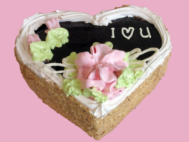 Stock image of 'Heart-like cake I Love You over pink'