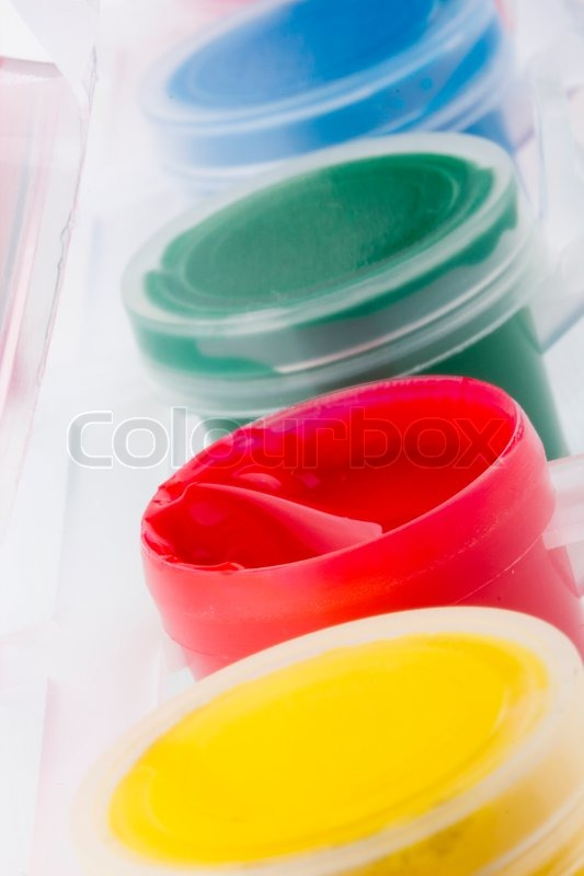 Open Plastic Container With Red Paint Next To Containers