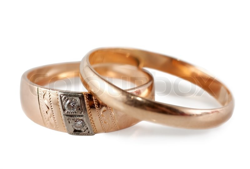 A pair of wedding rings male and female isolated over white