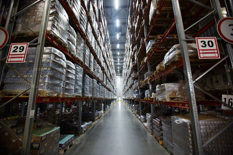Aisle in warehouse between shelves with goods, stock photo
