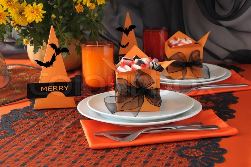 festive table decoration for halloween with candy in a box