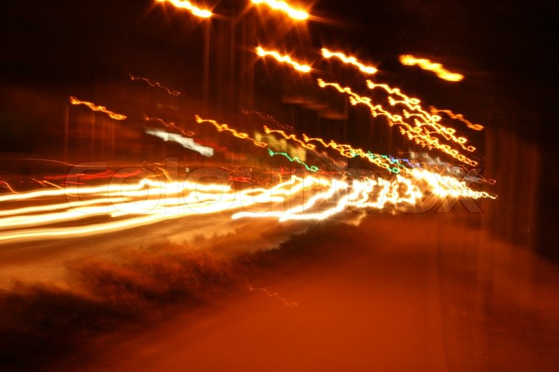 Car lights and street lamps lights in the night, stock photo