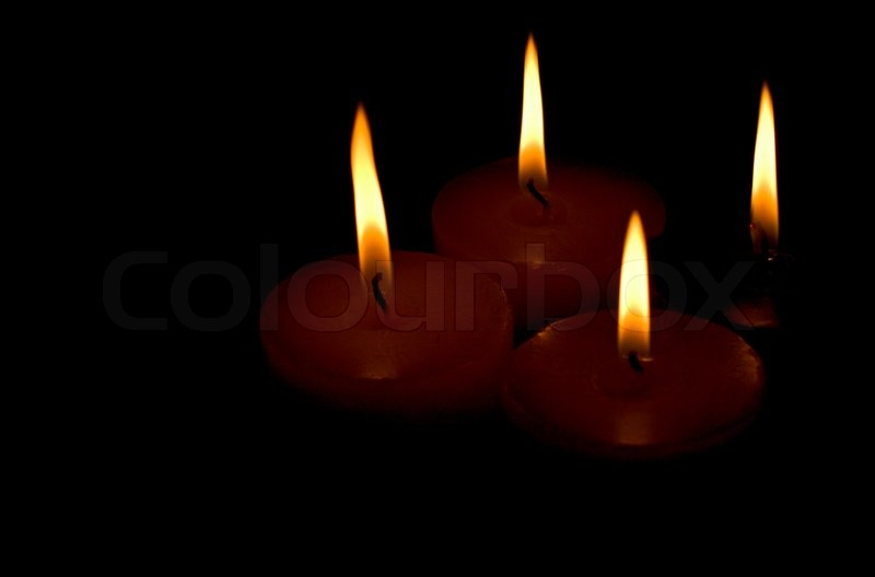 Four Candles On Black Background Stock Photo Colourbox