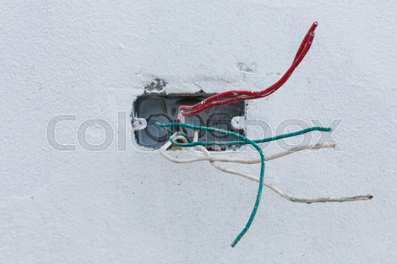 Electric wire on white cement wall in construction site industry ...