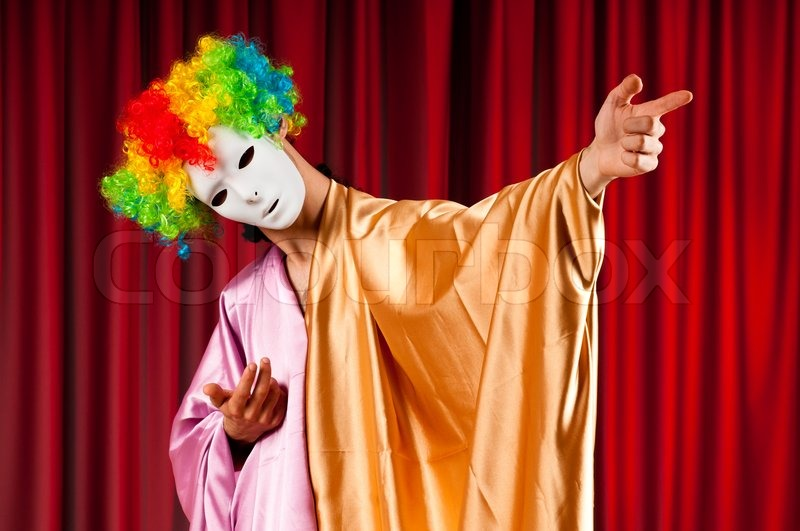 Actor with maks in a funny theater concept, stock photo