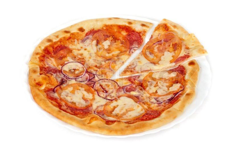 Pizza closeup with salami, tomato, onion and mozzarella ...