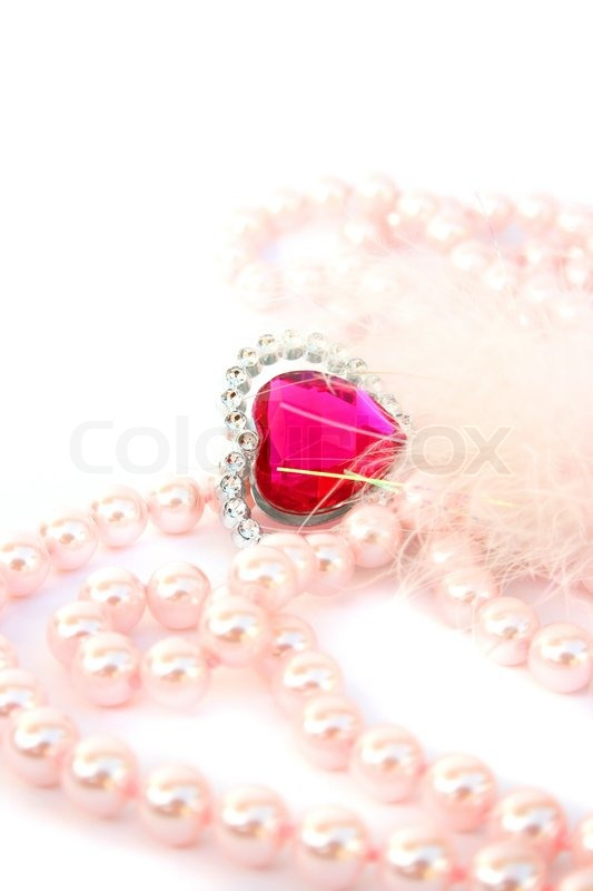Valentine red heart,pink pearls and feather isolated on ...