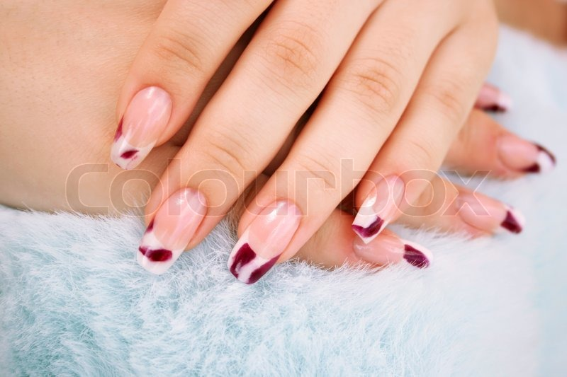 Woman Hands With Nail Art On Blue Fur Background Stock Photo