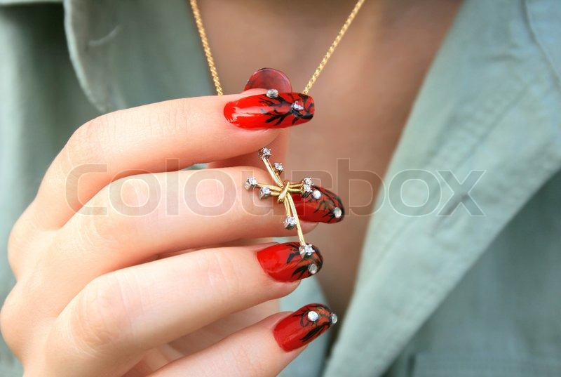 Nail Art Fingers Holding Golden Cross With Necklace Stock Photo Colourbox