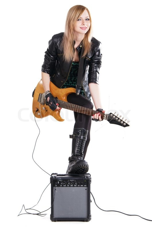 Teenage Girl Playing Electric Guitar Against White