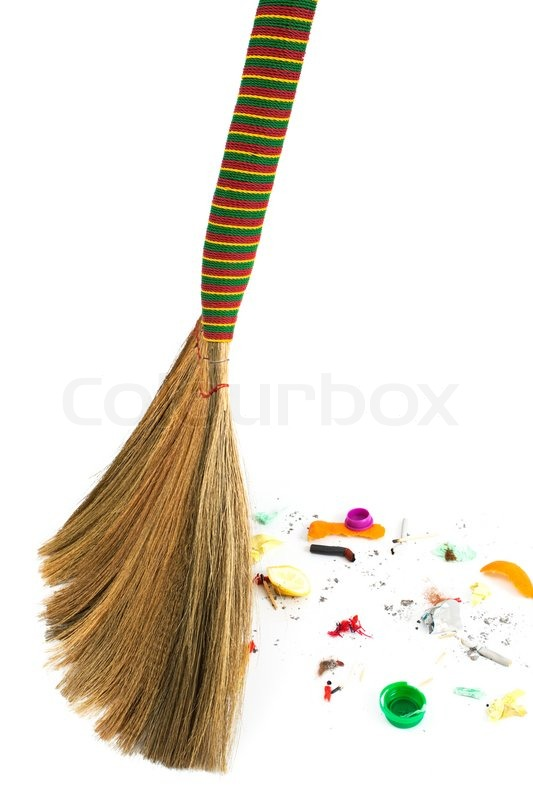 A new broom sweeping various debris and     | Stock image