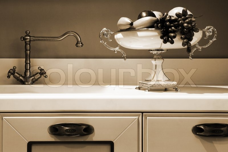 Fresh fruits washed in the modern kitchen, stock photo