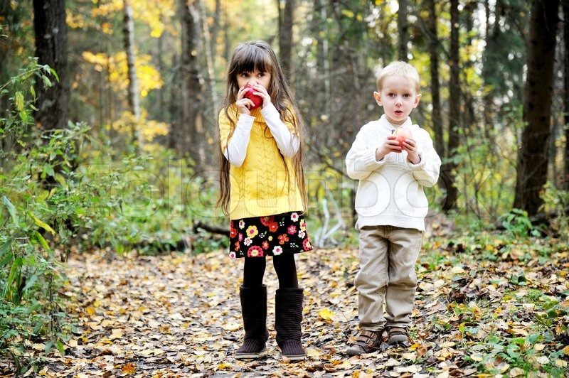 Cute Boy And Child Girl Eating Apples Stock Photo Colourbox