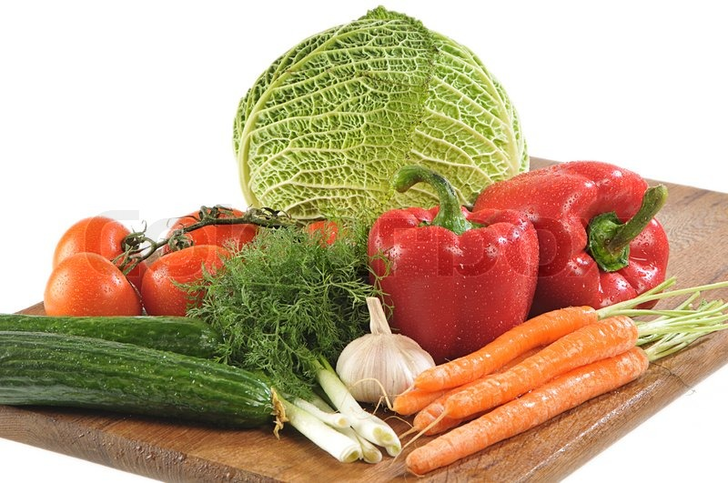 Stock image of 'Close-up shot of colorful different vegetables on board'
