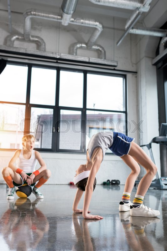 Funny kids in sportswear training at fitness studio together, children sport concept, stock photo