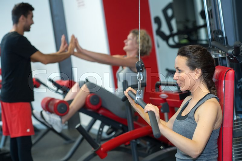 Friends working out at the gym, stock photo