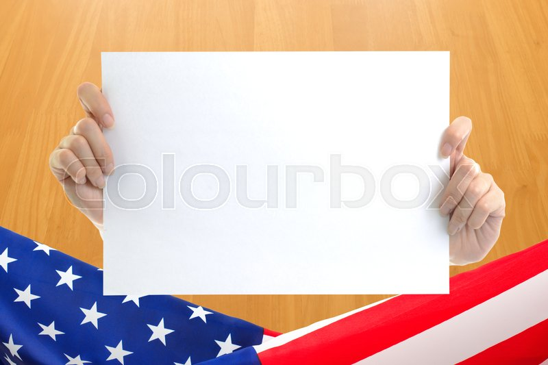 hand holding white blank paper sheet mockup with us flag border on