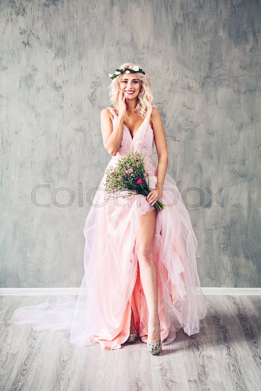 Stock image of 'Laughing Sexy Woman in Evening Gown. Happy Model Girl with Flowers'