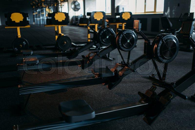 Gym nobody, empty fitness club. Strength training machine. Sport center equipment, stock photo