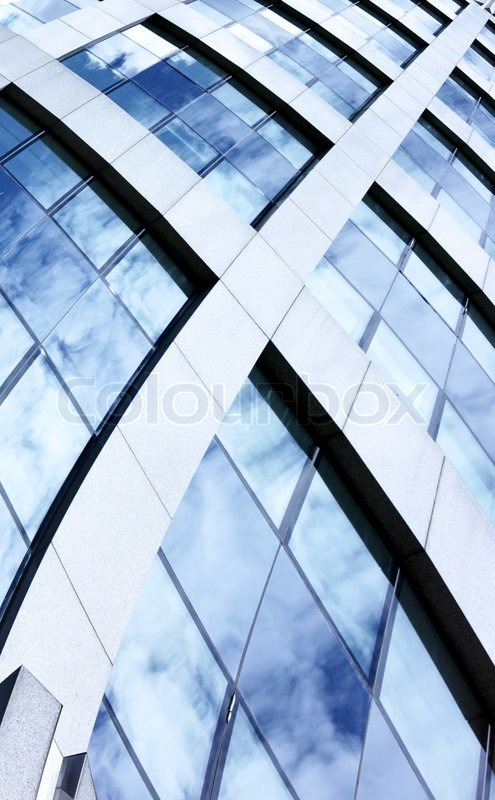 Stock image of 'Abstract architectural background with building and sky reflction in the windows'