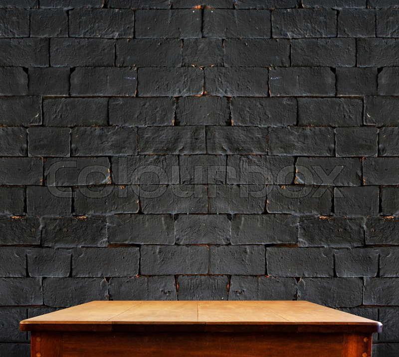Black brick wall and wooden tableperspective background Stock