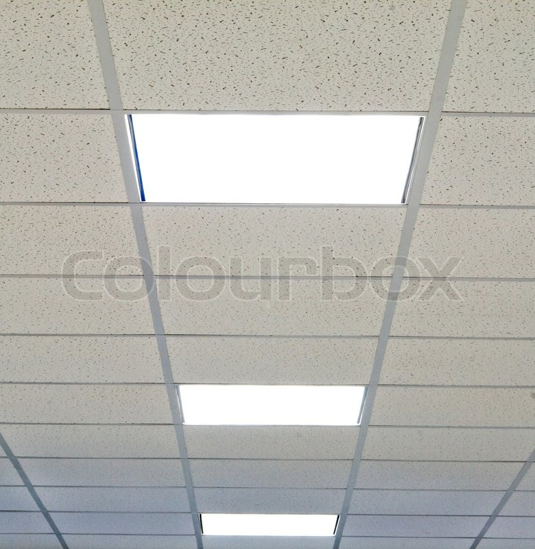 office ceiling with fixtures and fire sensors | stock photo