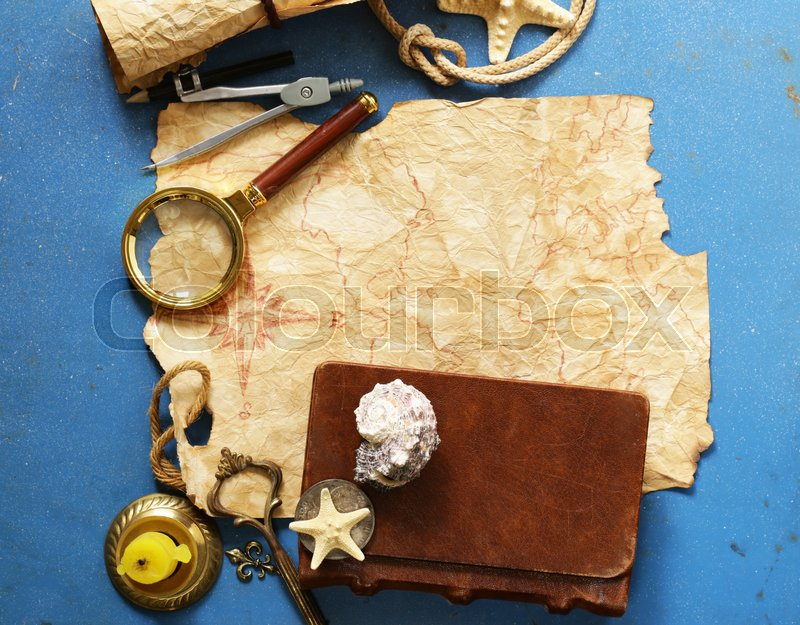 Vintage map, compass, magnifier - adventure and treasure hunt, stock photo