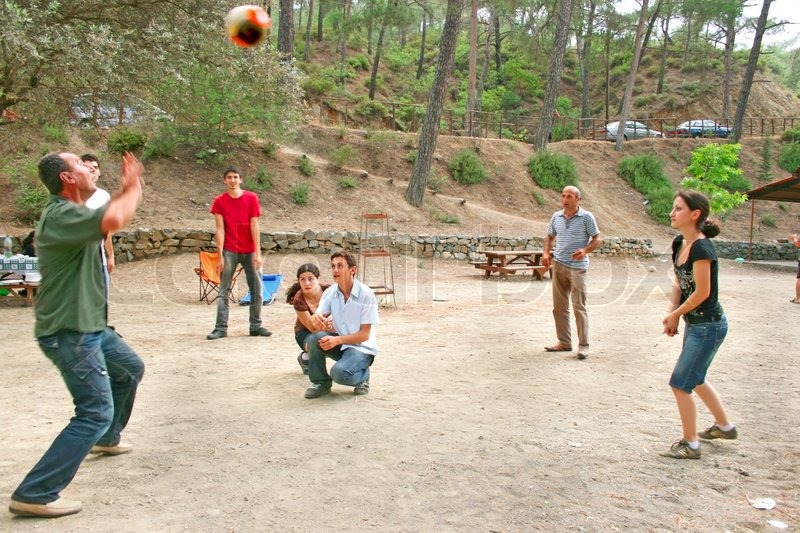Group Of Young People Playing Ball In The Forest Stock