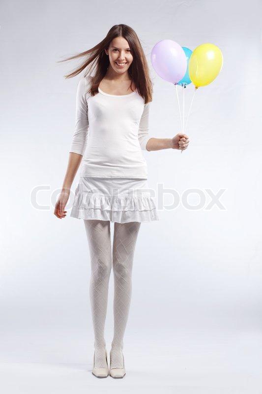 mode schuss sch ne junge frau mit urlaub ballons in ihren. Black Bedroom Furniture Sets. Home Design Ideas