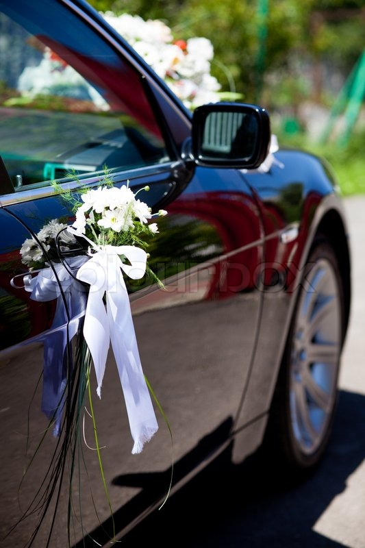 Wedding decoration closeup on the black car | Stock Photo | Colourbox