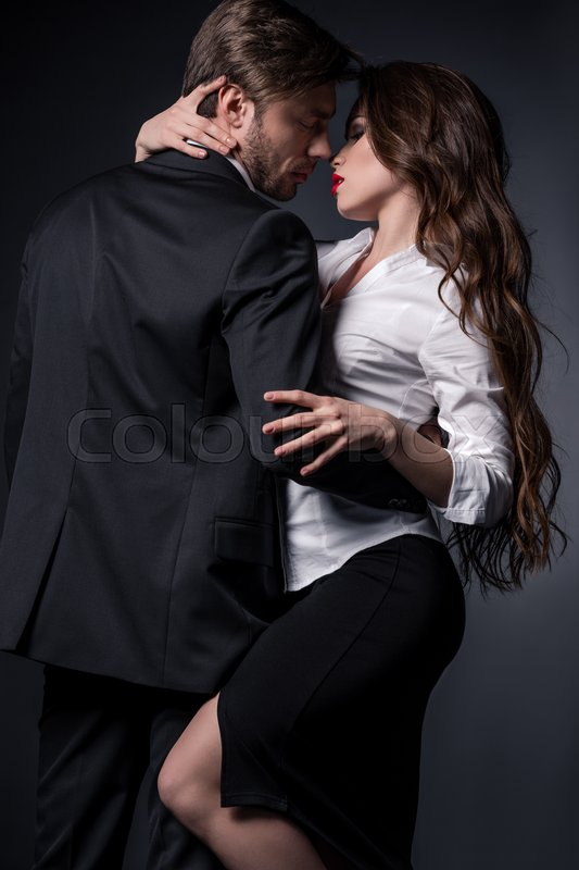 Young Sensual Couple In Love Embracing And Able To Kiss In Erotic Scene Stock Photo Colourbox