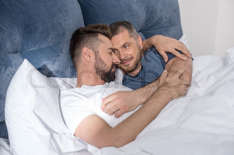 Happy Gay Couple Lying Embracing In Bed   Stock Photo -4357