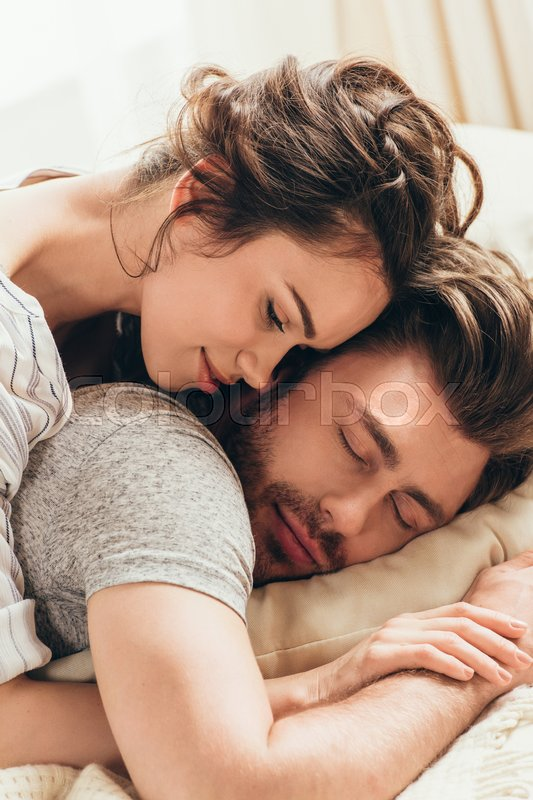 Sensual Young Woman Hugging Handsome Man Sleeping On Bed At Morning
