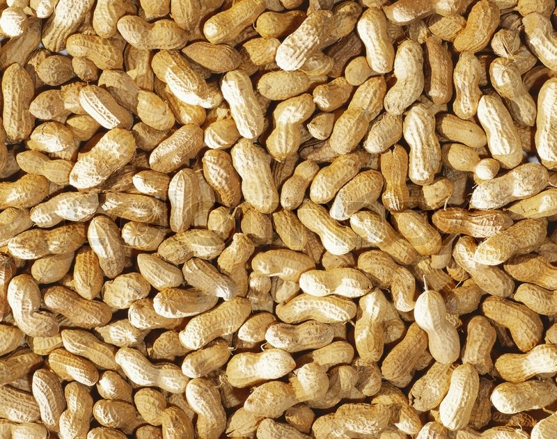 Close-up of some peanuts background brown, calories,   Stock Photo ...