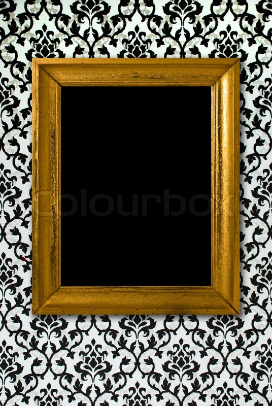 Gold frame on a black and white wallpaper | Stock Photo | Colourbox