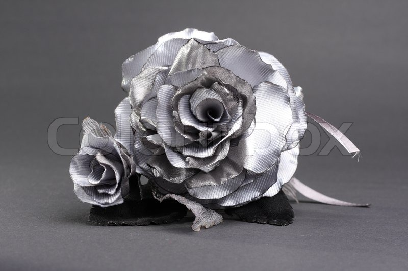 Artificial Silver Rose At Grey Background