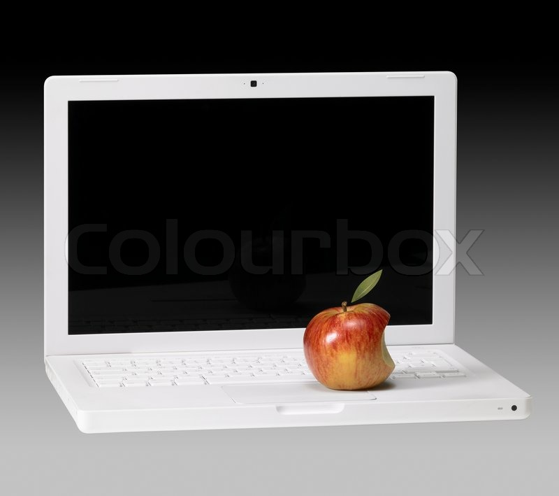 Symbolic theme showing a white Apple laptop and apple in ...