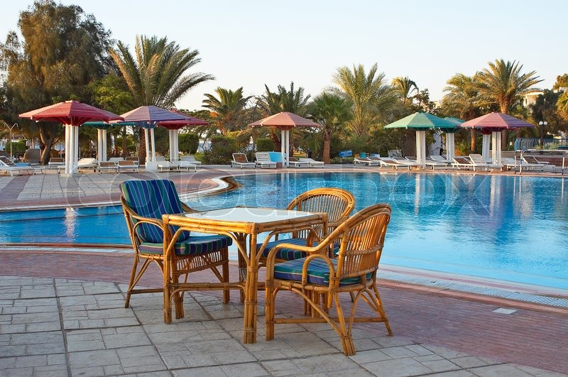 Three Arm Chair And One Table Near Swimming Pool Stock Photo Colourbox