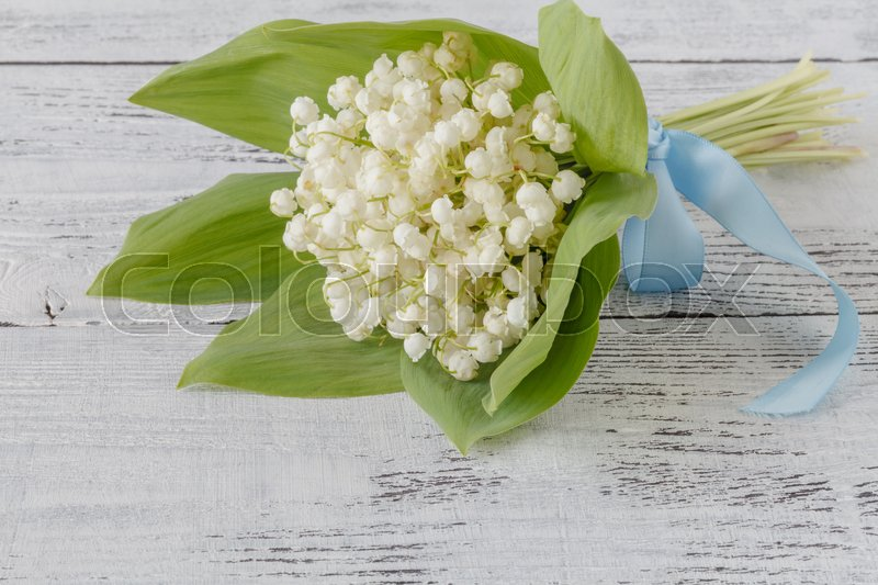 Beautiful bouquet of lilies of the valley, stock photo