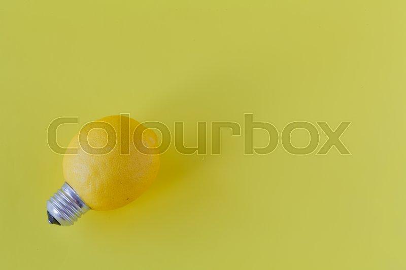 Lemon in the form of light bulbs on a yellow background. lemon lamp, stock photo