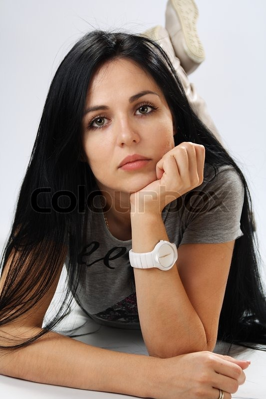 http://www.colourbox.com/preview/2696078-282835-portrait-of-young-woman-with-black-hair-lying-on-the-floor-in-the-studio.jpg