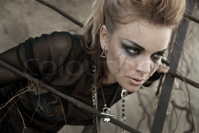 the girl dressed and makeup in rock style stock photo
