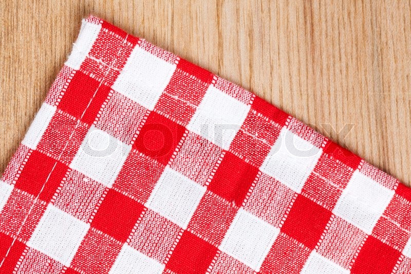 The checkered tablecloth on wooden table, stock photo