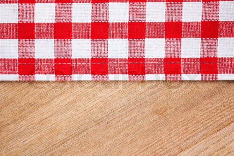 The checkered tablecloth on wooden ... | Stock image | Colourbox