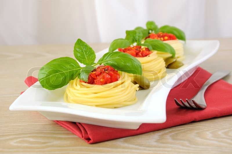Nest of spaghetti with tomato and basil dressing | Stock Photo ... | {Anrichten 27}
